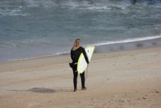 Girl preparing to surf on the OBX