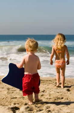 Two kids enjoying a day on the beach in Kill Devil Hills NC