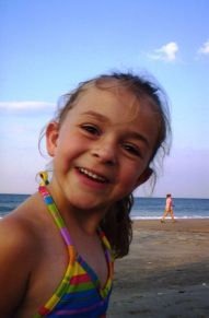 Happy girl on the beach in Kitty Hawk North Carolina